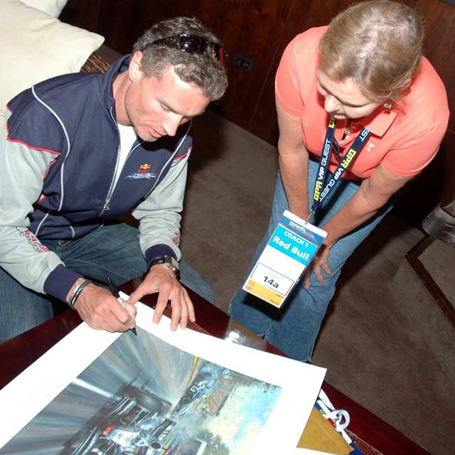 david coulthard signing a picture for a fan