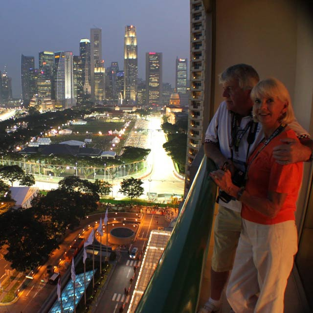 happy couple overlooking the track in singapore