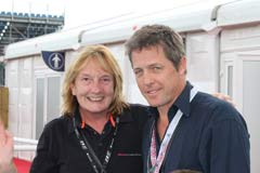 Hugh Grant and guest at silverstone