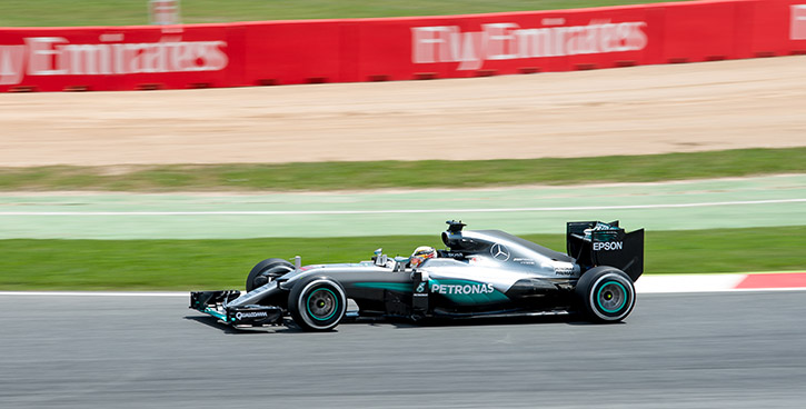 lewis hamilton racing in his mercedes at the spanish grand prix