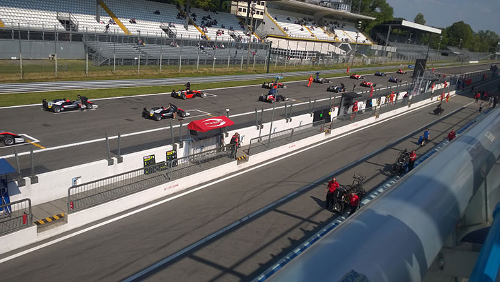 the starting grid at monza full of racing cars waiting to go